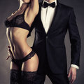 Sensual couple art photo of a young in lingerie and a tuxedo Stock Photos