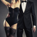 Sensual couple art photo of a young in lingerie and a tuxedo Stock Image