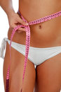 Sensual female body with bikini and tape measure Royalty Free Stock Photo