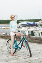 Sensual girl with bicycle on the sea and yacht background outdoors lifestyle Royalty Free Stock Photos