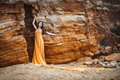 Sensual girl on the rocks Royalty Free Stock Photo
