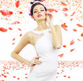 Sensual lady with the petals in the background brunette woman rose Royalty Free Stock Photo