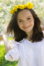 Sensual lovely woman with dandelion wreath in spring garden Royalty Free Stock Images