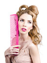 Sensual pin up woman with elegant hair style female model holding massive pink brush stylish care Stock Images