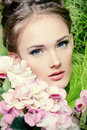 Sensual portrait of a beautiful girl with flowers spring Stock Photo