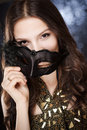 Sensual secrecy elegant gorgeous young brunette woman hiding behind festive mask Stock Photo