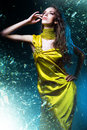 Sensual sexy woman in green dress and broken glass Royalty Free Stock Images