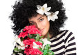 Sensual spring beauty beautiful young woman with a bouquet of seasonal blooms wild curly afro hairstyle adorned lily flowers Royalty Free Stock Photography