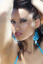 Sensual tanned beach woman with intense look eyes Royalty Free Stock Photo
