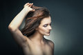 Sensual woman with beautiful long brown hairs young posing studio shot Stock Photo