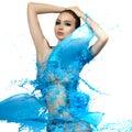Sensual woman and big paint waves blue splash Royalty Free Stock Photo
