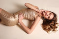 Sensual woman with blond curly hair  in elegant gold dress Royalty Free Stock Photo