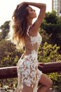 Sensual woman with blond hair in luxurious lace dress fashion outdoor photo of beautiful posing summer park Stock Photography