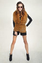Sensual woman in fur beautiful fashion model posing a vest and shorts Royalty Free Stock Photos