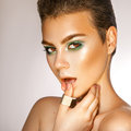 Sensual woman with green colors makeup in studio looking at came Royalty Free Stock Photo