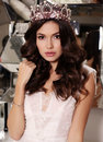 Sensual woman with long dark hair wears elegant lace suit and precious crown Royalty Free Stock Photo