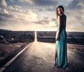 Sensual woman in a long dress