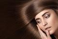 Sensual woman model with straight dark hair. Shiny long health hairstyle Royalty Free Stock Photo
