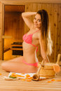 Sensual woman relaxing in sauna. Spa wellbeing. Royalty Free Stock Photo