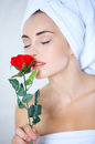 Sensual woman smelling a red rose Royalty Free Stock Photo