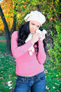 Sensual  woman with white cap in the autumn park Stock Photos