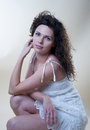 Sensual woman in a white sundress the studio Royalty Free Stock Photo