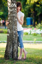 Sensual women and birch tree Stock Images