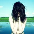 Sensual young woman on lake Royalty Free Stock Photo