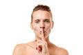 Sensual young woman making a hush gesture