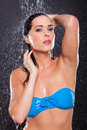 Sensual young woman posing water splashes black background Royalty Free Stock Photography