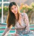 Sensuality Asian Woman Sitting On A Beach Sofa On The Beach Side For Vacation And Relaxation Cocnept