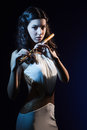 Sensuality brunette plays a wooden flute Royalty Free Stock Photos
