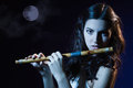 Sensuality brunette plays a wooden flute beauty Stock Photos