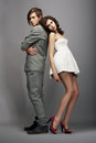 Sensuality romance newlyweds couple back to back two fashionable people posing in studio Stock Photo