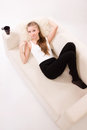 Sensuality woman lying on a sofa Royalty Free Stock Images