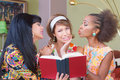 Sentimental friends reading novel three diverse mature women book Royalty Free Stock Photography