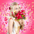 Sentimental lady with flowers falling in love creative portrait of a delightful young girl romancing when smelling the scent red Royalty Free Stock Image