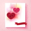 Sentimental valentine card design with hearts pink and red formed of petals on a shaded background a pink border and red banner Royalty Free Stock Image