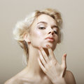 Sentimentality natural blonde woman touching her clean face pampering pretty Stock Photo