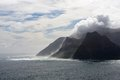 Sentinel cliffs cape town cloud shrouded mountain at hout bay near Royalty Free Stock Photos