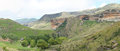 The sentinel and glen reenen camp site in the golden gate highla rest highlands national park south africa stitched panorama from Royalty Free Stock Images