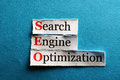 Seo abbreviation conceptual acronym on blue search engine optimization Royalty Free Stock Image