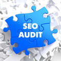 Seo audit on blue puzzle white background Stock Photography