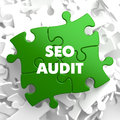 Seo audit on green puzzle white background Stock Photos