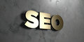 Seo - Gold sign mounted on glossy marble wall - 3D rendered royalty free stock illustration