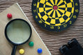 SEO optimization concept with, dartboard, binoculars and magnify