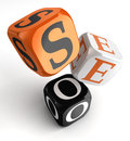 Seo orange black dice blocks on white background clipping path included Royalty Free Stock Photo