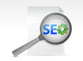 Seo on paper shit under magnifying glass Royalty Free Stock Photo