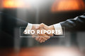 SEO REPORTS Concept Business team hands at work with financial r