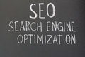 Seo search engine optimization inscription in chalk on a blackboard Stock Images